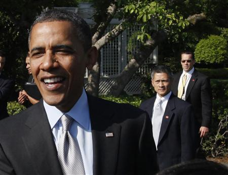U.S. Secret Service agents are pictured behind President Barack Obama as he greets audience members after sending off the Wounded Warrior Project's Soldier Ride on the South Lawn of the White House in Washington, April 20, 2012. REUTERS/Jason Reed