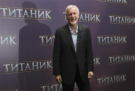 U.S. film director James Cameron poses for a photograph during a presentation for the media in Moscow March 29, 2012. REUTERS/Ivan Burnyashev