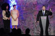 Chaz Bono (R) speaks after being presented the Stephen F. Kolzak Award by Mary Bono Mack (C) and Cher at the GLAAD Media Awards in Los Angeles April 21, 2012. REUTERS/Phil McCarten