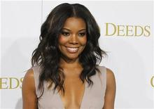 """Actress Gabrielle Union, one of the stars of director Tyler Perry's new film """"Good Deeds"""", poses at the film's premiere in Los Angeles, California February 14, 2012. REUTERS/Fred Prouser"""