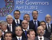 Finance ministers and central bank governors pose for a family photo before the International Monetary and Financial Committee (IMFC) meeting during the spring IMF-World Bank meetings in Washington April 21, 2012. REUTERS/Yuri Gripas