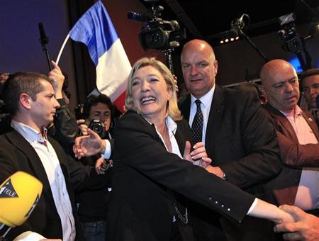 Marine Le Pen, National Front Party Candidate for the 2012 French presidential election, greets supporters in Paris after early results in the first round vote of the 2012 French presidential election, April 22, 2012. REUTERS/Pascal Rossignol