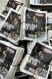 Посвященный выборам номер газеты Liberation в типографии под Парижем 22 апреля 2012 года. Избиратели, голосовавшие в первом раунде президентских выборов во Франции за националистку Марин Ле Пен, могут определить исход схватки между правоцентристом Николя Саркози и социалистом Франсуа Олландом во втором туре. REUTERS/Charles Platiau