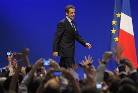 France's President and UMP party candidate for the 2012 French presidential elections Nicolas Sarkozy is greeted by supporters as he stands on stage at La Mutualite meeting hall in Paris after early results in the first round vote of the 2012 French presidential election April 22, 2012. REUTERS/Philippe Wojazer