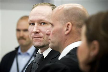 Norwegian anti-Muslim fanatic Anders Behring Breivik (2nd L) stands with his defence lawyer Geir Lippestad (2nd R) during the morning break on the sixth day of his trial in Oslo April 23, 2012. REUTERS/Heiko Junge/NTB Scanpix/Pool