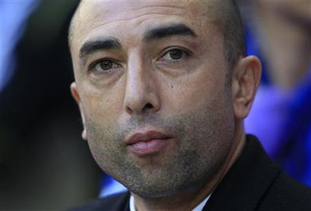 Chelsea's manager Roberto di Matteo takes his seat before their FA Cup semi-final soccer match against Tottenham Hotspur at Wembley Stadium in London, April 15, 2012. REUTERS/Eddie Keogh