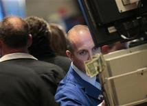 Traders work on the floor of the New York Stock Exchange (NYSE) September 12, 2011. REUTERS/Brendan McDermid