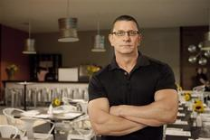 British chef Robert Irvine poses in this undated handout picture from Food Network. REUTERS/Food Network/ Handout