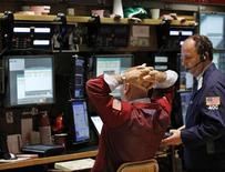 Traders work on the floor of the New York Stock Exchange, April 23, 2012. REUTERS/Brendan McDermid