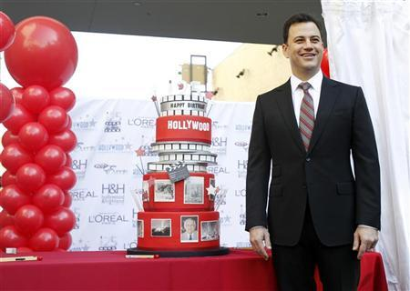 Television host Jimmy Kimmel poses next to a cake during a celebration for the 125th anniversary of the City of Hollywood in Hollywood, California February 1, 2012. REUTERS/Mario Anzuoni
