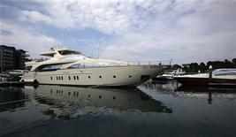 A luxury yacht is berthed at the One Degree 15 Marina Club at Sentosa Cove in Singapore April 25, 2012. REUTERS/Tim Chong