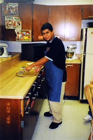 George Zimmerman is pictured making a pizza in a home economics class at Osbourn High School in Manassas, Virginia in 2000 in this handout photo obtained by Reuters April 25, 2012. REUTERS/Zimmerman Family/Handout