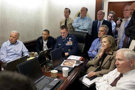 U.S. President Barack Obama (2nd L) and Vice President Joe Biden (L), along with members of the national security team, receive an update on the mission against Osama bin Laden in the Situation Room of the White House, May 1, 2011. Also pictured are Secretary of State Hillary Clinton (2nd R) and Defense Secretary Robert Gates (R). REUTERS/White House/Pete Souza/Handout/Files