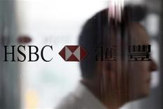 A man walks past the HSBC logo at the bank's headquarters in Hong Kong September 8, 2011. EUTERS/Tyrone Siu