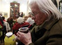 A woman sips mate (a type of herbal tea) at the Museo de la Ciudad in Buenos Aires July 20, 2010. REUTERS/Enrique Marcarian