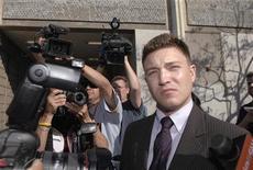Actor Lane Garrison leaves Beverly Hills Superior Court in California March 8, 2007. REUTERS/Phil McCarten