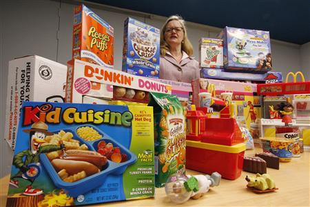 Margo G. Wootan, Director of Nutrition Policy for the Center for Science in the Public Interest displays foods. toys and giveaways marketed by the food industry towards young children in Washington, April 24, 2012. REUTERS/Jim Bourg