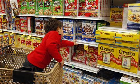 A child reaches for a box of Lucky Charms cereal at a grocery store in Annandale, Virginia April 24, 2012. REUTERS/Kevin Lamarque (UNITED STATES)