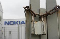 A padlock is pictured in front of the factory of Nokia in Bochum January 16, 2008. REUTERS/Ina Fassbender
