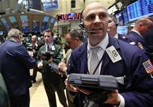 Traders work on the floor of the New York Stock Exchange April 25, 2012. REUTERS/Brendan McDermid