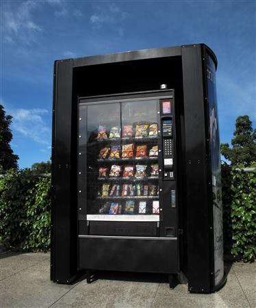 A vending machine is shown at a transit stop in Encinitas, California April 24, 2012. REUTERS/Mike Blake