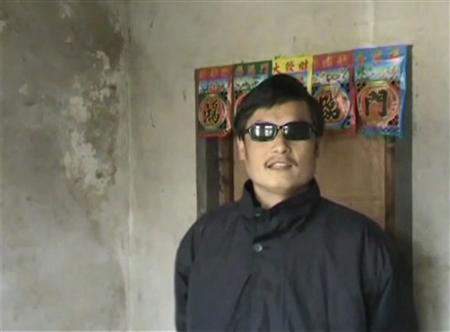 Blind legal activist Chen Guangcheng stands in his village home in Linyi in eastern Shandong province, in this still image taken from file video. REUTERS/Chinaaid via Reuters TV/Handout