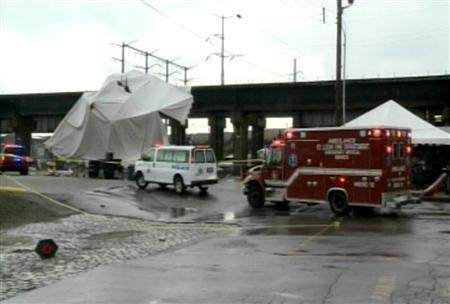 Rescue workers surround the site of a beer tent blown down by high winds in St. Louis, Missouri April 28, 2012 in this still image taken from video. REUTERS/KSDK/Handout.