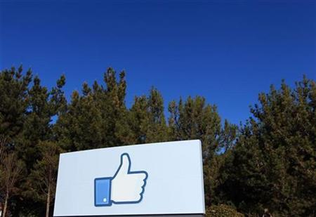 A giant ''like'' icon made popular by Facebook is seen at the company's new headquarters in Menlo Park, California January 11, 2012. REUTERS/Robert Galbraith/Files