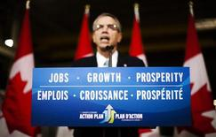 """A sign reading """"Jobs, Growth, and Prosperity"""" is seen as Natural Resources Minister Joe Oliver speaks at a news conference in Toronto, April 17, 2012. REUTERS/Mark Blinch"""