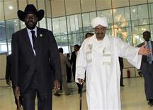Sudan's President Omar al-Bashir welcomes his South Sudanese counterpart Salva Kiir during his arrival at Khartoum Airport October 8,2011 for his first visit since southern secession to discuss key unresolved issues, including Abyei and oil, that have undermined north-south relations. REUTERS/ Mohamed Nureldin Abdallah