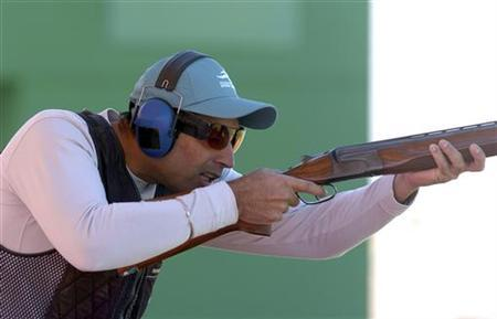 World champion trap shooter Manavjit Singh Sandhu of India competes during the men's shooting trap final at the Asian Games in Doha December 3, 2006. REUTERS/Mohammad Youssef/Files