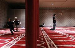 Children play behind a curtain to separate the men and women in a prayer hall at the Islamic Cultural Center of New York in the Manhattan borough of New York August 26, 2010. REUTERS/Lucas Jackson
