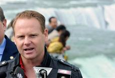 Nik Wallenda speaks about his upcoming wire walk over the Canadian (Horseshoe) Falls, as he stands at the American Falls, Niagara Falls May 2, 2012. REUTERS/Doug Benz