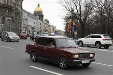 An AvtoVAZ Lada 2107 car is seen driven along a road in St. Petersburg May 2, 2012. Russia is ending its long love affair with a car that was once prized by the nation but has come to symbolise the decline of its automobile industry and, for some, the country itself. The decision by state car maker AvtoVAZ to halt production of the last models in the Lada Classic series this year after four decades is more than just the end of the road for an automobile. Picture taken May 2, 2012. To match Feature RUSSIA-CAR/ REUTERS/Alexander Demianchuk