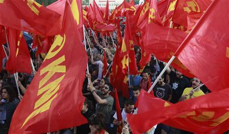 Supporters of the Greek Communist Party raise their flags during an election campaign rally in Athens May 2, 2012. Greece will hold a snap election on May 6. REUTERS/John Kolesidis