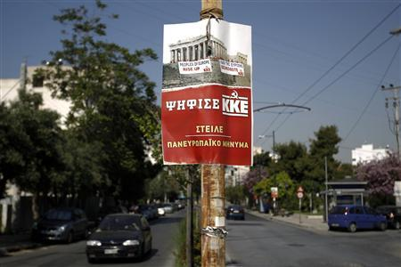 A pre-election poster of Greece's Communist party is seen on a pole in Athens May 3, 2012. Greece holds general elections on May 6. REUTERS/Yorgos Karahalis
