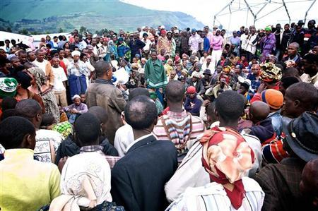 Newly arrived refugees from the Democratic Republic of Congo gather to listen to a Rwandan government official at the Nakamira transit camp from the La Corniche border crossing near Gisenyi, northwest Rwanda, May 2, 2012, after fleeing the Masisi region in Congo's North Kivu province after fighting broke out between Congolese troops and fighters loyal to a renegade general. REUTERS/Graham Holliday
