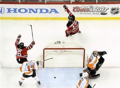Kings crush Blues, Devils ground Flyers