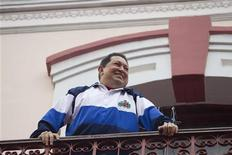 Venezuelan President Hugo Chavez stands at the People's balcony at Miraflores Palace in Caracas April 13, 2012. REUTERS/Carlos Garcia Rawlins