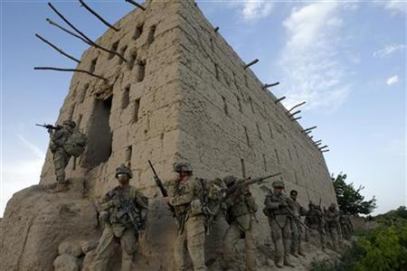 U.S. soldiers from 5-20 infantry Regiment attached to 82nd Airborne enter a barn while on patrol in Zharay district in Kandahar province, southern Afghanistan April 26, 2012. REUTERS/Baz Ratner