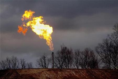 A gas flare burns at a fracking site in rural Bradford County, Pennsylvania January 9, 2012. REUTERS/Les Stone