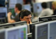 A trader at IG Index looks at his screens at their offices in the City of London March 15, 2011. REUTERS/Andrew Winning