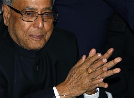 Finance Minister Pranab Mukherjee attends a business meeting in New Delhi December 2, 2010. REUTERS/B Mathur/Files