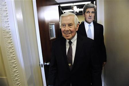 US Senator Richard Lugar (R-IN) (C) and Senator John Kerry (D-MA) (R) walk out together after a news conference after the Senate ratified the START nuclear arms reduction treaty at the US Capitol in Washington, December 22, 2010. REUTERS/Jonathan Ernst