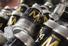 Cans of Molson beer are seen at a news conference in Montreal, March 19, 2012. REUTERS/Christinne Muschi