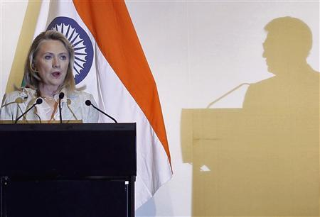 U.S. Secretary of State Hillary Clinton speaks during a joint news conference with India's Foreign Minister Somanahalli Mallaiah Krishna in New Delhi May 8, 2012. The shadow of Foreign Minister Krishna is seen on the right. REUTERS/Adnan Abidi