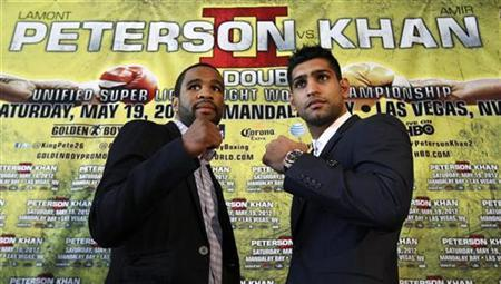 Welterweight boxers Lamont Peterson of the U.S. (L) and Amir Khan of Britain pose during a news conference in Washington March 15, 2012, to announce their rematch in May. REUTERS/Kevin Lamarque/Files