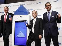 Softbank Corp President Masayoshi Son (C) poses with eBay Inc President and CEO John Donahoe (L) and PayPal President David Marcus during a news conference in Tokyo May 9, 2012. REUTERS/Yuriko Nakao
