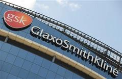 Signage is pictured on the company headquarters of GlaxoSmithKline in west London. REUTERS/Toby Melville