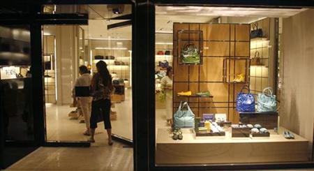 A customer enters a showroom at the Emporio mall in New Delhi September 9, 2008. REUTERS/Adnan Abidi/Files